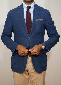 Blue sport coat, white shirt with light blue dress stripes, dark red tie, khakis