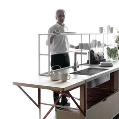 Meccanica  Looking for a flexible and light structured shelving system? Do not look further. I would like to share Meccanica, a great minimalist shelving system by Demode, engineered by Valcucine, with you.
