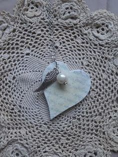 This heart pendant with its adornments of a pearl and an angel wing charm feels so romantic and feminine. The verses depicted on the heart are Proverbs 31:16-18.