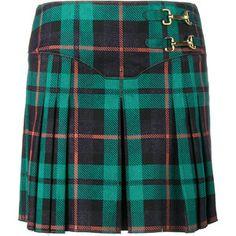 More traditional plaid skirt/kilt.  Esteban Cortazar pleated tartan denim mini-skirt.  ($435 BROWNSFASHION.COM)