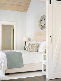 gorgeous soft bedroom palette; wood paneled ceiling; barn doors