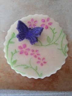Icing decorated with card embossing folders and lustre dust and edible glitter