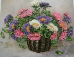 Asters in a basket. Main view.   Midway - is a thin thread knitting.   Tatiana Yalaguzyan