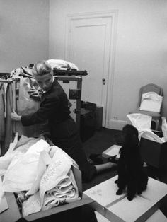 Actress Grace Kelly Packing for Wedding to Prince Rainer of Monaco While Pet Poodle Looks On Premium Photographic Print
