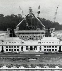 Canberra: the massive flagpole of Australia's New Parliament House under construction on the of April, Old Parliament House stands in front. Australia Capital, Aussie Australia, Australia Travel, Historical Romance Authors, House Under Construction, Houses Of Parliament, Facade Design, Capital City, 1980s