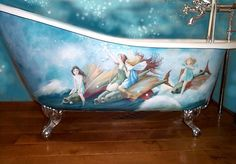 This cast iron bath was hand painted with sea fairies and fish