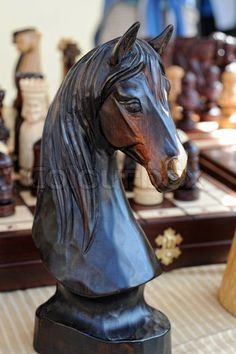 Wooden chess piece - a horse head stock photo