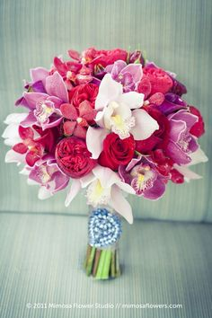 Red roses and mokara orchids + pale pink cymbidium orchids + purple mini cymbidium orchids