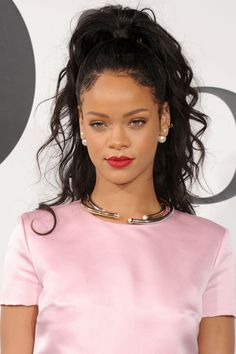 Is there anything Rihanna can't pull off? Her take on the half up/half down hair comes with a some curls and a mess of a pony (in the best way).   - MarieClaire.com