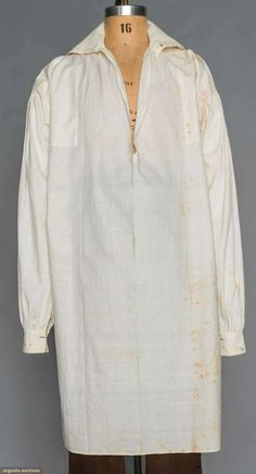 "MAN'S DAY SHIRT, AMERICAN, 1790-1810 White cotton, open F to chest, sleeves top gathered, underarm triangular gussets, fabric re-enforced at underarms, neck & side vent openings, CH 52"", L 40"", (brown stains) very good. James Kochan - Don Troiani Collections - Augusta Auctions"