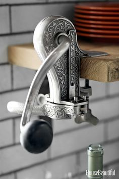 An antique wine bottle opener comes in handy, especially if you have a vineyard nearby.   - HouseBeautiful.com