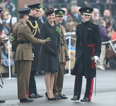 Prince William & Kate Middleton present Shamrocks to the Irish Guard for St. Patrick's Day. Kate was wearing a bespoke brown coat by Catherine Walker, brown suede Emmy 'Valeria' pumps, the Lock and Company 'Betty Boop' hat, Cornelia James 'Imogen' gloves, & a brown suede Emmy 'Natasha' clutch. - 3/17/2015
