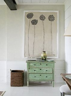 Simple canvas & green chest feels airy.