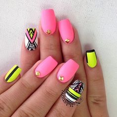 Neon pink and yellow matte nail art with black detailing and gold embeleshments
