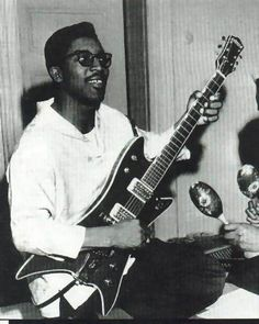 """Bo Diddley and his """"Cadillac"""" guitar"""