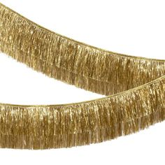 Shop this Meri Meri Gold Tinsel Fringe Garland and bring a touch of your own personality to your Christmas decorations with free delivery