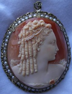 MUSEUM QUALITY PORTRAIT CAMEO | ca.1840-50 | Italy | cornelian shell, seed pearls, sterling silver frame | 2.25 in. x 1.875 in.| Museum quality | supposedly depicts Queen Marie Antoinette Queen of France (1755-1793) | beautifully carved very detailed cameo, frame enhanced by seed pearls | Rare cameo, desirable collectors' piece | sterling silver assay mark |