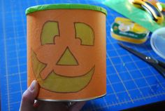 DIY Halloween luminaries from recycled baby formula cans! You can also make these cute and cheap Halloween decorations from oatmeal containers. Diy Halloween Luminaries, Cheap Halloween Decorations, Halloween Diy, Fall Crafts, Crafts To Make, Baby Formula Cans, Formula Containers, Oatmeal Container, Paper Lanterns