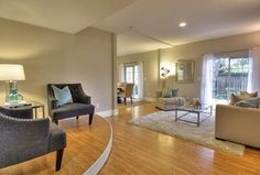 Contemporary Living Room with Sunken living room, Upper Eastside Coffee Table by Wildon Home, Hardwood floors, High ceiling