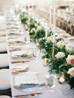 Elegant garland topped wedding tablescape: http://www.stylemepretty.com/2015/12/08/scottsdale-wedding-at-silverleaf-golf-club/ | Photography: Erich McVey - http://erichmcvey.com/
