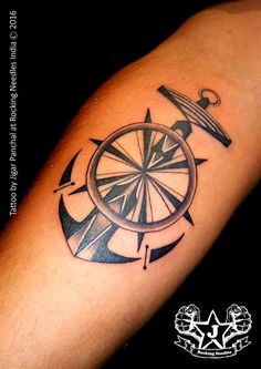 Photo: Tattooed on merchant navy guy (captain)  Anchor with steering of a ship Both resembles the key control of a ship #rulethesea #respect #everytattoohashisstory Tattoo artist: Jigar panchal