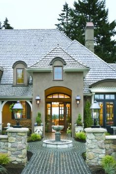 French Country Elegance traditional exterior; stucco home with slate roof