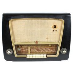 "Vintage Phillips international radio decor with internal circuit boards and tubes.  Product: RadioConstruction Material: Wood and metalColor: Black, brown and goldFeatures: For decorative purposes onlyDimensions: 15"" H x 20"" W x 10.5"" DNote: Due to the vintage nature of this product, some wear and tear is to be expected. Products may show signs of brand marks, scrapes or other blemishes. Cleaning and Care: Wipe with damp cloth"