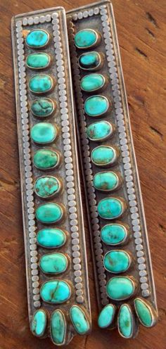 The turquoise in these beautiful old collar tabs has a deep blue-green color. Each one has 14 stones. Most likely these were made for Navajo use on a velvet blouse. Susan Swift - Santa Fe NM