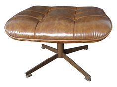This is a very nice vintage Eames era style ottoman for a lounge chair. The ottoman or foot stool has a metal base and 4 metal legs. It is quite heavy duty which leads me to believe it is older. The cushion for the ottoman is supported by an angled section of heave gauge metal mesh, the cushion slips over the ends like a glove. I am not sure if the cushion is leather or vinyl, it is very soft and supple.  The maker: The label that was once on the cushion is long gone and there are no other…