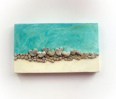 Unique Wall Decor made of actual genuine beach pebbles - Love on the Rocks What you see is what you het Ready to ship. Gift wrapped Ready to hang  Size:       ~14 *  ~ 8 inches   / /    35 * 20 cm Colors:   turquoise and gold  This is a mixed media work -acrylic on canvas, and genuine heart shaped beach rocks glued to it. The rocks  were found on the shore of the Mediterranean sea  in Israel.  They are 100% natural. their color is beige / grey .  This is a great gift for wedding A beautiful…
