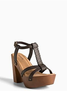 "<p>Boho babes --> walk this way to these heels! The chunky wooden heel is 70's inspired, while the rich chocolate brown faux leather T-strap has been braided for a flower child contrast.</p><ul>	<li>4.75"" heel with 1.5"" platform</li>	<li>Man-made materials</li>	<li>Imported</li></ul>"