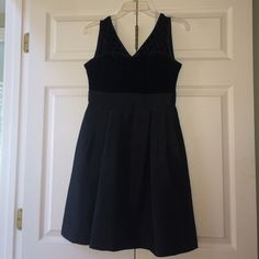 Black Fit and Flare Dress NEVER WORN!! Super fun Black dress - polka dots on top and polyester bottom! Still have receipt ModCloth Dresses