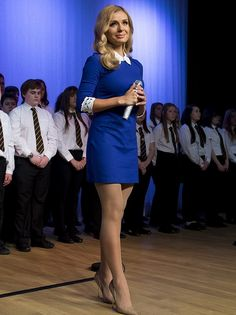 Katherine Jenkins in her gliding mini dress visits a native school, at morning assembly. She sung with students and gifted her new CD to her music teacher.