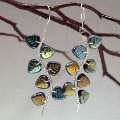 Glass leaf #beads with a shimmery coating -  love #botanical #jewelry!