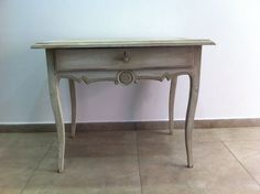 French antique grey vanity table with medallion carving and elegant curved legs.