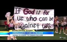 """Input this picture because I just think it's a good reminder that cheerleaders are often very religious, and aren't afraid to show how they feel. As the sign says, """"If God is for us, who can be against us?"""""""