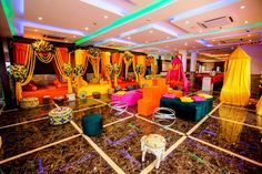 Check out how the #splash of #colours have given a #vibrant appeal to this #mehendi party. #banquetinjodhpur #weddingsatkasturi