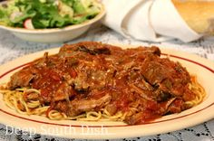 Spaghetti Daube is a well loved Deep South dish and not surprising because it is such a budget stretcher. A slow braised beef, it is cooked in, then shredded and returned to a lovely Creole sauce. Serve over spaghetti noodles.
