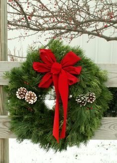 I love the simple old school traditional stuff!  That's just me!  Christmas wreath on  fence