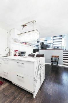 Check out the full renovation of a triplex apartment in New York City incuding two bathroom remodels and a kitchen overhaul. Real Kitchen, Old Kitchen, Peninsula Lighting, Glass Shower Panels, Cool Kitchens, Small Kitchens, Shower Fixtures, Wall Mounted Vanity, Low Cabinet