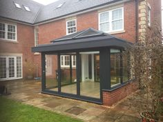 This customer had seen the work we had done for their neighbour and wanted us to build a new orangery for them at the rear of their home in anthracite grey. House Extension Plans, Building Extension, House Extension Design, Extension Ideas, Rear Extension, Orangery Extension Kitchen, Conservatory Extension, Garden Room Extensions, House Extensions