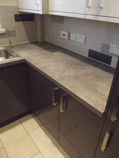 Showing the worktops contrasting with the tiles.