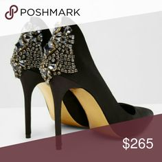 """🚨FREE SHIPPING📬😲 Ted Baker Mieno embellished New!!  Fit for a screen siren, these pointy toe pumps feature an array of diamant' crystals at the extended heel counter, while a curvy topline, pointy toe and slim stiletto heel finish this glamorous style.   4"""" heel (size 9.5 ). Textile upper/leather lining/synthetic sole. By Ted Baker London; imported New, no box Ted Baker Shoes Heels"""