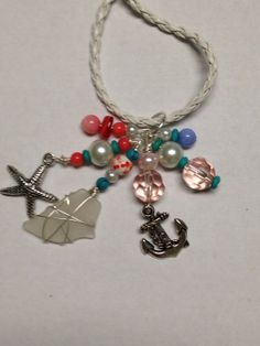 Charm Necklace with Silver Charms and Blue by DayDreamingDecor, $25.00