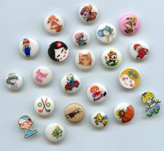 20 small pictorial plastic buttons plus 2 realistic....available at Pegs ecrater