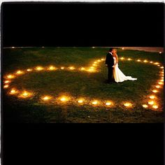 This could be done with luminarias. It's romantic and it would be perfect for a summer/fall wedding. I want this!!!!!