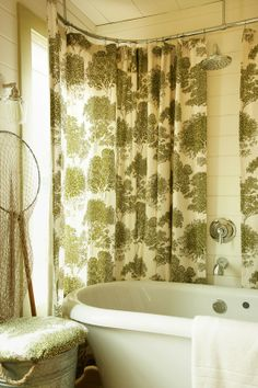 freestanding tub with showercurtain