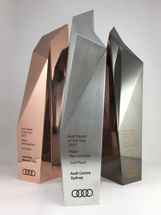 Metal sculptural award, bespoke design trophy with electroplated finish & digital print. Created by Artisaned Awards. Wayfinding Signage, Signage Design, Audi Dealership, Packaging Design, Branding Design, Sign System, Trophy Design, Metal Art Sculpture, Boutique Design