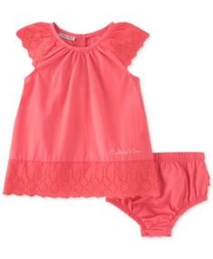 Calvin Klein makes sure that baby girl looks good and stays cool on warm days with this adorable coral-hued dress and diaper cover set, finished with delicate eyelet lace at the sleeves and hem for an