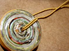 Aother recycled magazine necklace. LOVE